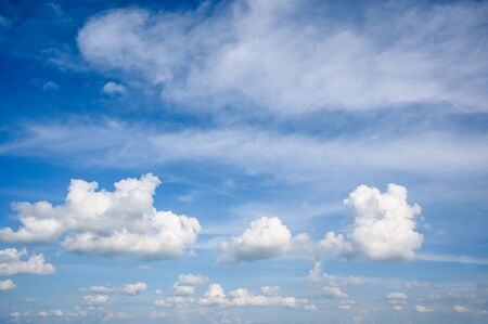 Blue sky with cumulus humilis clouds. weather forecast background