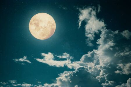 Romantic night scene - Beautiful full moon with cloud in night skies.  Retro style with vintage color tone. 写真素材