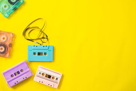 Retro cassette tape recorder on yellow background, flat lay, top view. retro technology