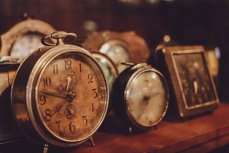 Vintage table clock, collectibles. retro alarm and timer clock. vintage color tone.