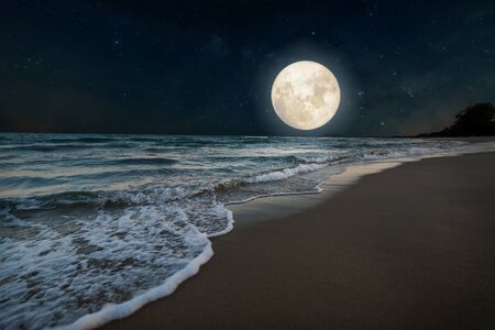 Beautiful nature fantasy - romantic beach and full moon with star. Retro style with vintage color tone. Summer season, honeymoon in night skies background concept.