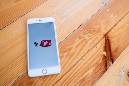Chiang Mai  Thailand - October 6 2018 :iPhone with youtube screen on wood desk