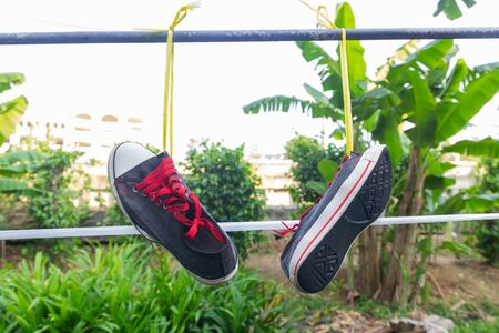 Shoes hanging after wash it 版權商用圖片
