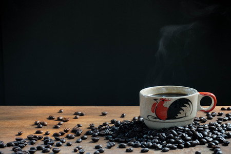 Coffee hot cups with smoke and coffee beans.