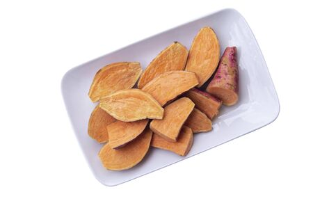 Red potatoes on a white plate and white background. Фото со стока - 131831208