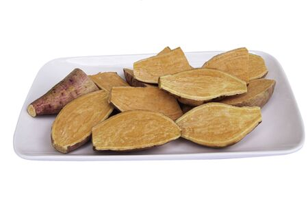 Red potatoes on a white plate and white background. Фото со стока