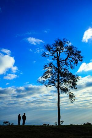 siluet: Siluet couple with blue sky  Stock Photo