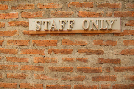 staff only: The masonry wall with the word  STAFF ONLY