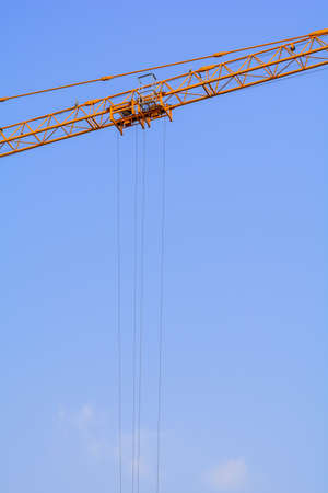 pulleys: Industrial construction cranes cable on the blue sky background
