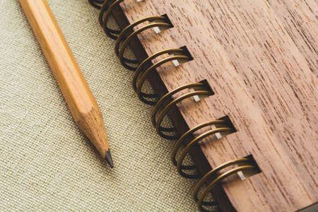 diagonal diary education: Pencil and spiral notebook on the canvas background, vintage color