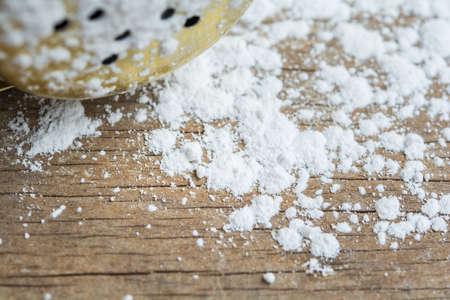 talc: Closeup white talcum powder on wooden background