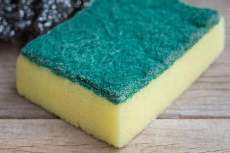 dishwashing: Dishwashing sponge on wooden background