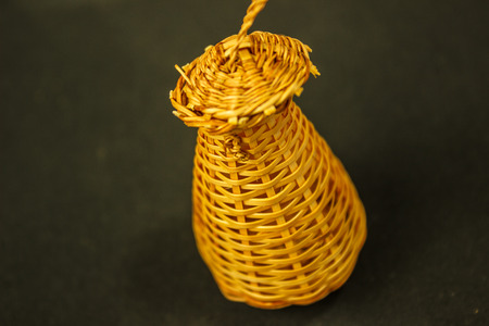 basketry: fish coop is Thai handmade basketry isolated on navy blue background. Stock Photo