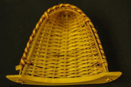 navy blue background: fish coop is Thai handmade basketry isolated on navy blue background. Stock Photo
