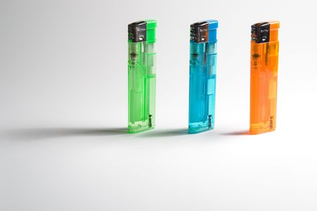 3 colored lighters, standing.