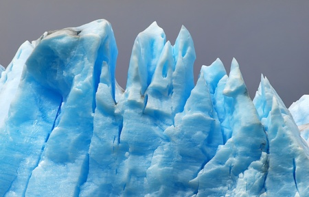 campo de hielo sur: blue icebergs isolated on grey background as seen at grey glacier in torres del paine national park, patagonia.