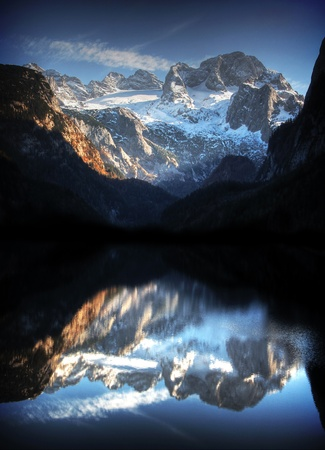 austrian alps with mountain lake photo
