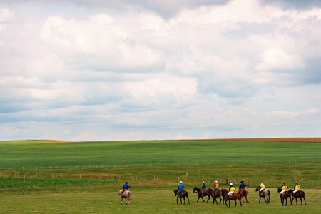 nature landscape with group of recreational polo players as seen in southern alberta, canada photo
