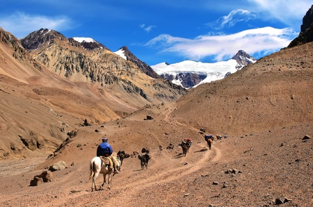 campo de hielo sur: beautiful mountain landscape near aconcagua with hikers in front trekking as seen in argentina, south america. Stock Photo