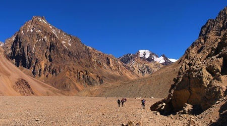 tal: beautiful mountain landscape with group of hikers in front as seen in the wilderness of argentina, south america.