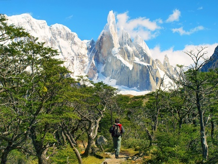 hiker trekking in scenic nature landscape with mt. fitz roy in the background as seen in los glaciares national park, patagonia, argentina photo