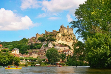 vacationer: nature landscape with river dordogne and Ch�teau de Beynac in the background as seen in the south of france Stock Photo