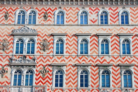 baukunst: facade detail of an old traditional building in italy, europe.