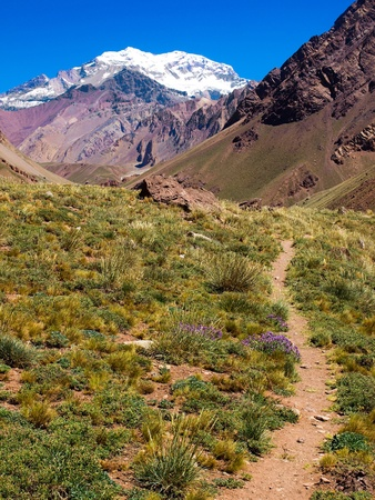 moreno glacier: Hiking path with Aconcagua in the background as seen in Aconcagua National Park, Argentina Stock Photo