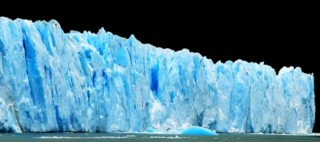 Panorama of blue icebergs isolated on black photo