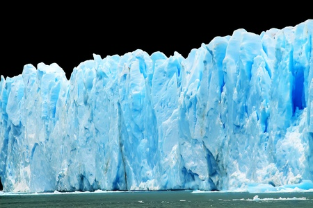 Blue icebergs isolated on black. Stock Photo - 11644954
