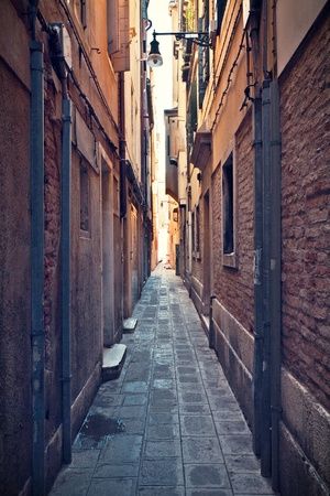 narrow: Small alley as seen in the city centre of Venice, Italy. Stock Photo