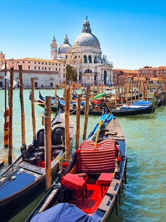 rialto bridge: Gondolas with Basilica di Santa Maria della Salute in Venice, Italy  Stock Photo