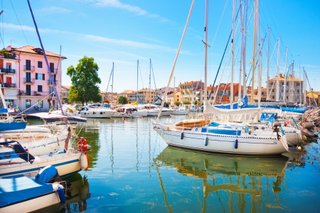 cote d'azure: Beautiful scene of boats lying in the harbor of Grado, Italy at Adriatic Sea   Stock Photo
