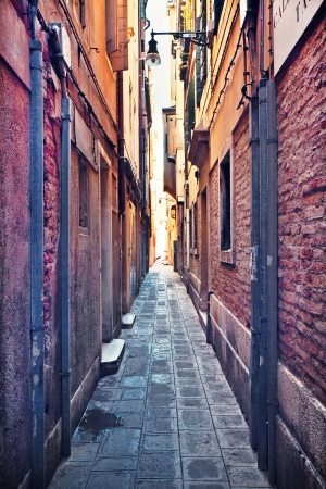 high end: Narrow alley in Venice, Italy Stock Photo