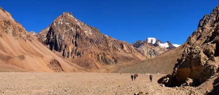 dry stone: Mountain panorama with hikers trekking in Andes in Aconcagua National Park, Argentina, South America