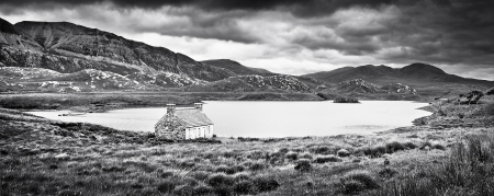 Dramatic landscape with old stone house at a lake on Isle of Mull, Scotland  photo