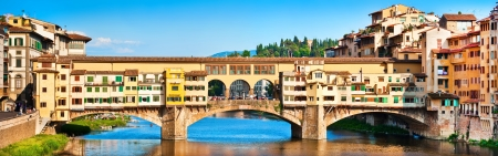 Panoramic view of famous Ponte Vecchio at sunset in Florence, Italy photo