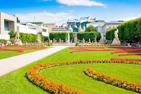 amadeus: Famous Mirabell Gardens with the old historic Fortress Hohensalzburg in the background in Salzburg, Austria