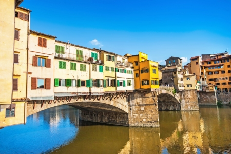 ponte: Famous Ponte Vecchio with river Arno at sunset in Florence, Italy