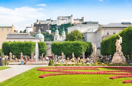 of mozart: Mirabell Gardens with Fortress Hohensalzburg in Salzburg, Austria Editorial