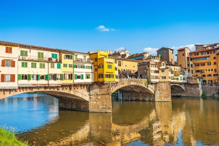 florence italy: Famous Ponte Vecchio with river Arno at sunset in Florence, Italy