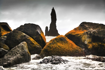 lowlands: Beautiful view of rock formations at Cape Dyrholaey near the village of Vik i Myrdal, southern Iceland Stock Photo