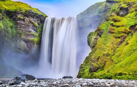 Long exposure of famous Skogafoss waterfall in Iceland at dusk photo