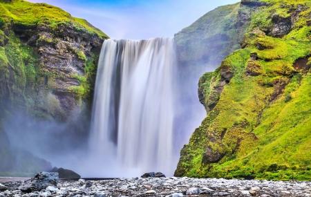 skogafoss waterfall: Long exposure of famous Skogafoss waterfall in Iceland at dusk