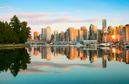 Beautiful view of Vancouver skyline with Stanley Park at sunset, British Columbia, Canada photo