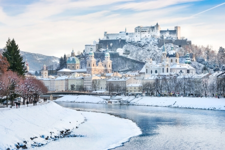 Salzburg skyline with Festung Hohensalzburg and river Salzach in winter, Salzburger Land, Austria photo