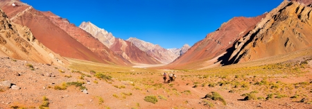 mendoza: Panoramic view of mountain valley in the Andes with hikers trekking, Argentina, South America