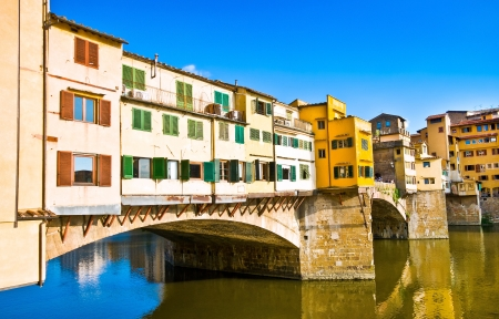 vechio: Ponte Vecchio with river Arno at sunset in Florence, Italy