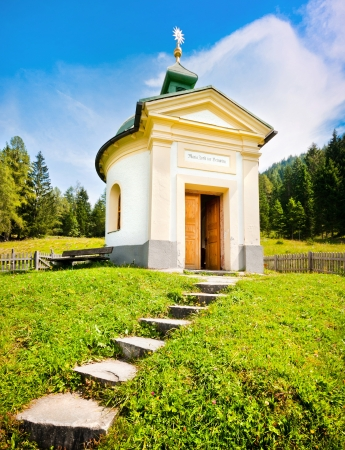 Small chapel with beautiful countryside in Pinzgau, Salzburger Land, Austria photo