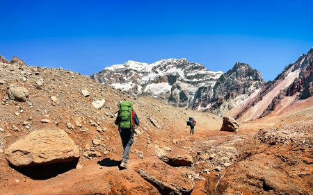 mendoza: Hikers on their way to Aconcagua as seen in the background, Aconcagua National Park, Argentina, South America